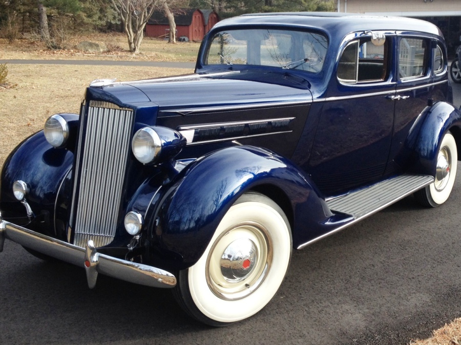 1937 PACKARD 115-C TOURING SEDAN.
